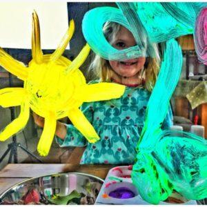 girl painting the sun