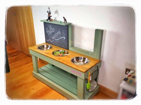 large mud kitchen side view chalkboard and wormery
