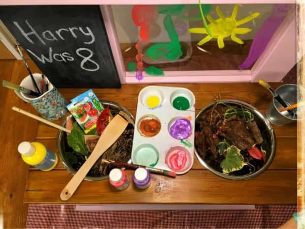 Kitchen work top with art easel and paints