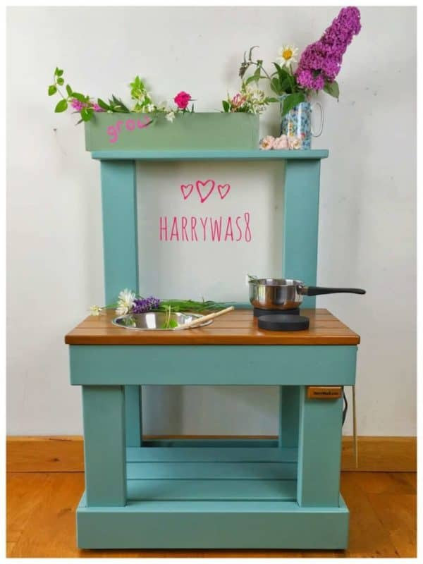 Small mud kitchen front view with flowers