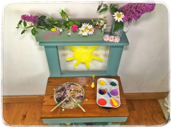 Mud kitchen with flowers and paints